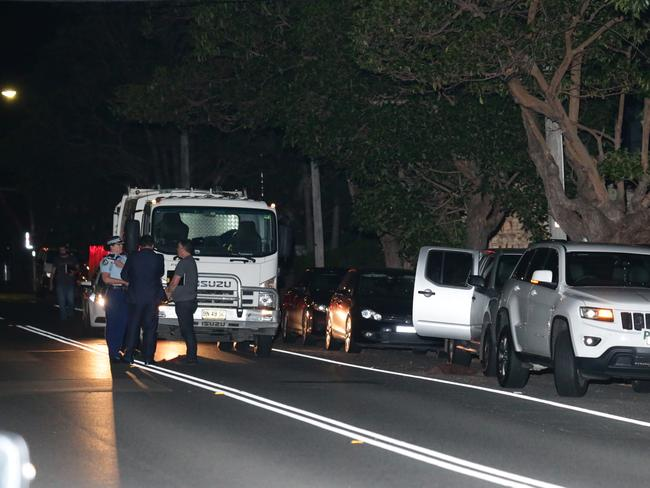 Police speak with witnesses at the scene in Strathfield. Picture: Bill Hearne