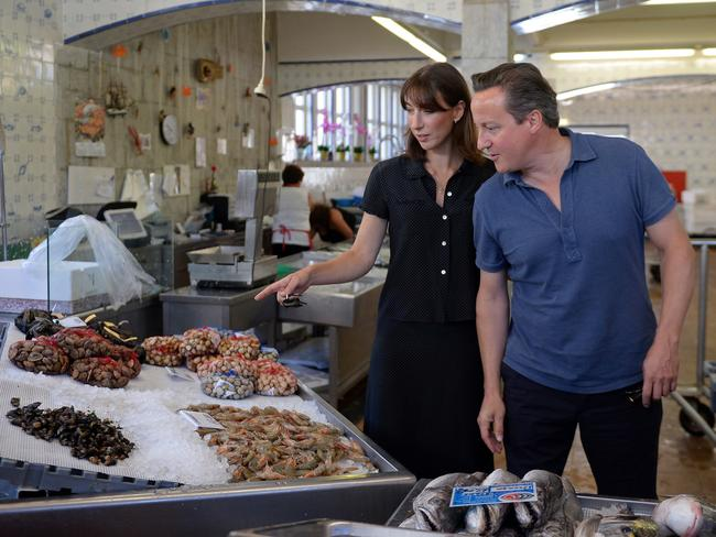 Another holiday, another blue shirt. UK Prime Minister David Cameron pictured with wife Samantha. Pic Getty.