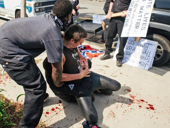 KKK rally ... Three people after a small group of Ku Klux Klan members clashed with a larger gathering of counter-protesters. Picture: AP