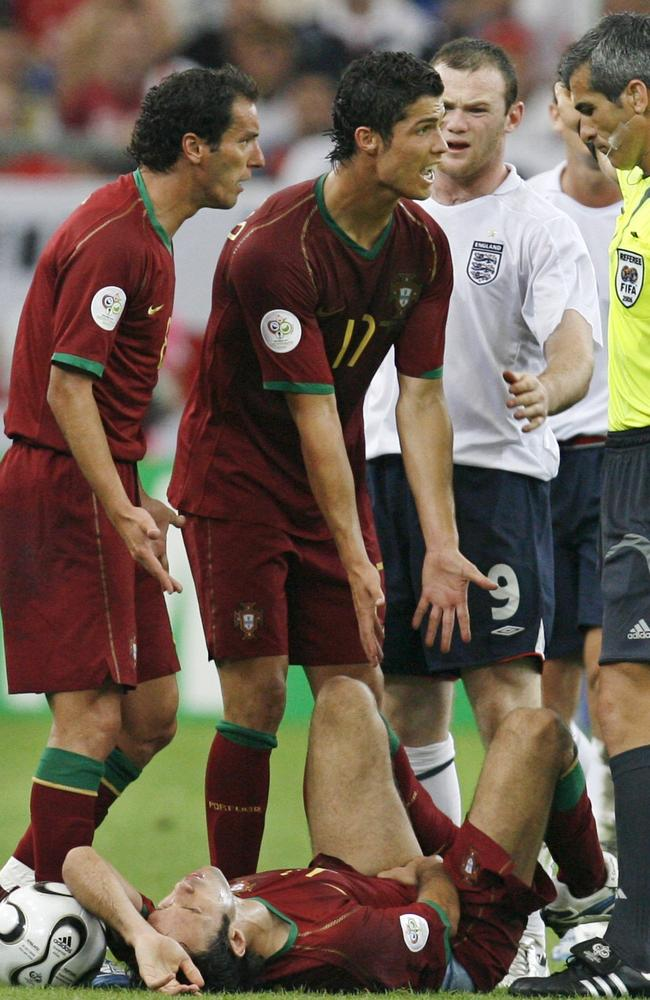 Portugal's Cristiano Ronaldo pleads with referee Horacio Elizondo to have his then Manchester United teammate Wayne Rooney sent off in their 2006 quarterfinal and ...