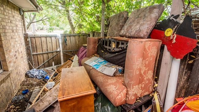 Furniture dumped outside the home.