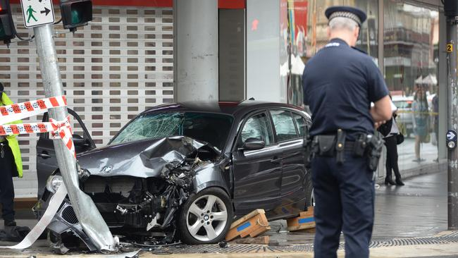 The car on the footpath at the corner of Rundle and Pulteney streets after the crash. Picture: Bernard Humphreys