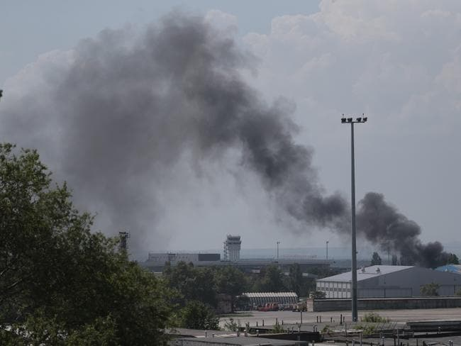 Airport battle ... Smoke rises at the airport outside Donetsk, Ukraine.