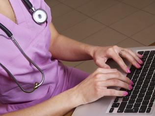 Female doctor working with laptop