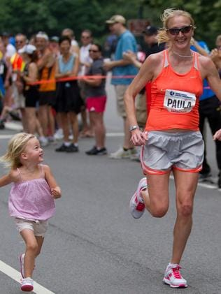A pregnant Paula Radcliffe running alongside her daughter three-year-old daughter Isla at the 2010 New York Mini 10K. Picture: Alamy
