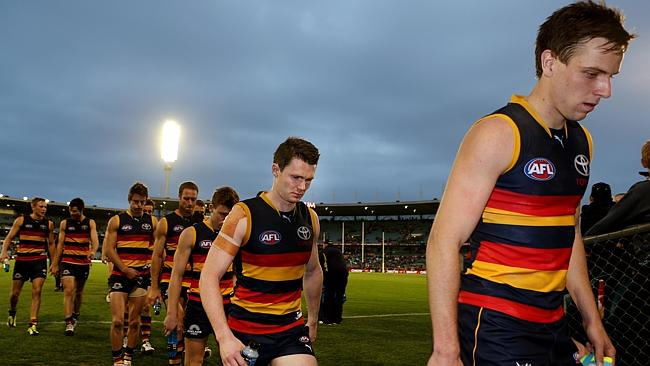 Dejected faces as Crows players learn that stocks of shiraz are slipping dangerously low in the clubhouse.