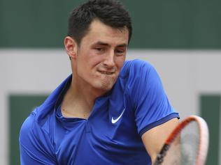 Australia's Bernard Tomic returns in his first round match of the French Open tennis tournament against Brian Baker of the U.S. at the Roland Garros stadium in Paris, France, Tuesday, May 24, 2016. (AP Photo/David Vincent)