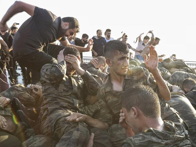 Soliders involved in the coup attempt surrender on Bosphorus bridge. Picture: Gokhan Tan/Getty Images