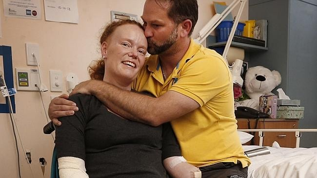 Mandy is hugged by her husband Rod McCracken. Picture: David Caird