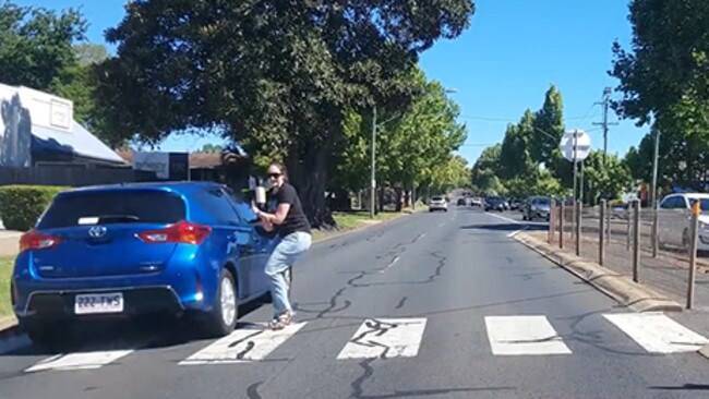 The pedestrian narrowly avoided being hit after Youtube user agentsmith2181 honked his horn to warn her the car was not slowing down.