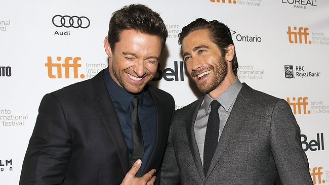 """Hugh Jackman shares a laugh with co-star Jake Gyllenhaal on the red carpet at the gala for the new movie """"Prisoners"""" during the Toronto International Film Festival. Picture: AP"""