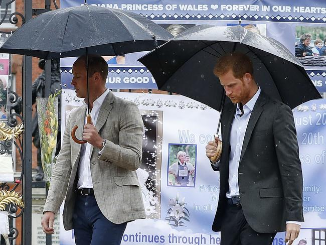 Prince William and Prince Harry walk away after placing flowers amongst the tributes to their late mother Princess Diana placed on the gates of Kensington Palace, London, Wednesday, Aug. 30, 2017. Picture: Kirsty Wigglesworth/AP