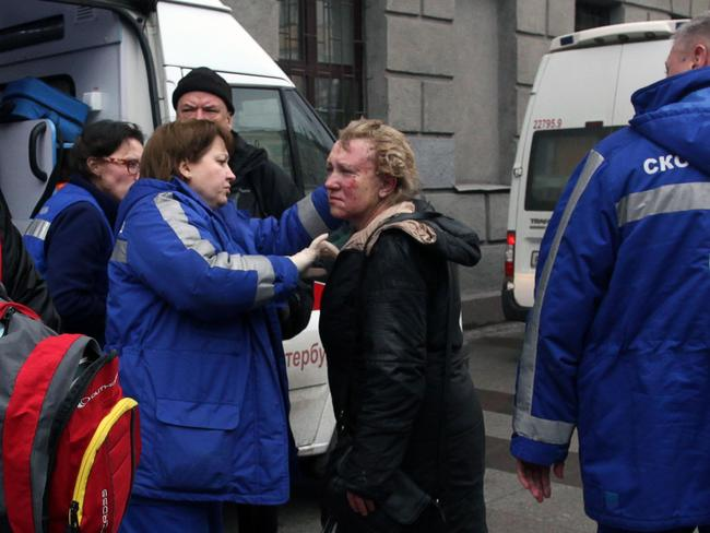 Medics help an injured woman outside Technological Institute metro station in Saint Petersburg on April 3, 2017. Picture: AFP.