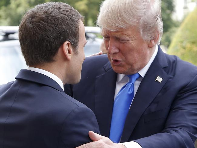 French President Emmanuel Macron welcomes U.S. President Donald Trump at Les Invalides museum in Paris. Picture: Photo/Michel Euler.