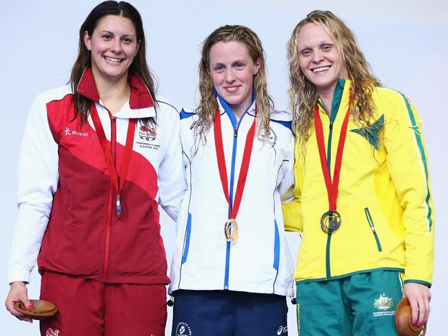 Bronze medallist Keryn McMaster (R) with gold medallist Hannah Miley (C) of Scotland and silver medallist Aimee Willmott (L) of England during the medal ceremony after the Women's 400m Individual Medley Final.