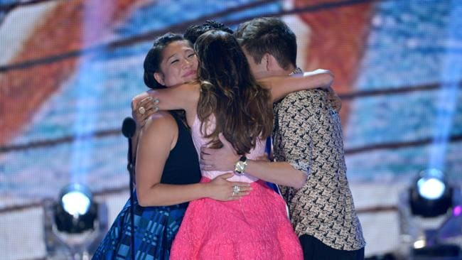 Jenna Ushkowitz, Lea Michele and Kevin McHale hug on stage at the Teen Choice Awards. Picture: Getty Images