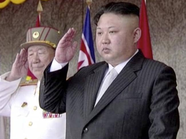 North Korea's leader Kim Jong-un salutes during a parade at Kim Il-sung Square in Pyongyang on Saturday. Picture: KRT via AP