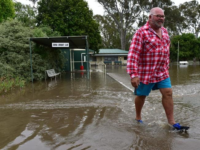 A local resident walks through the floodwater in Euroa. Picture: AAP
