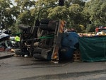 The truck on its side. Picture: Sam Kelton