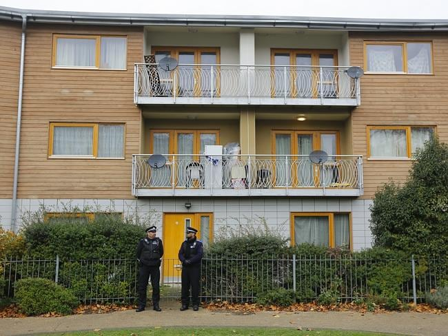 Police continue to stand guard for a second day outside a South London block of flats that is being investigated in connection with the alleged slavery case.
