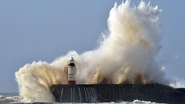 Changed forever ... The huge storms and powerful winds, like this seen in Newhaven on the south coast of England, have caused years' worth of erosion and damage.