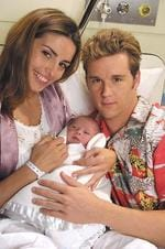"Actors Ada Nicodemou & Ryan Kwanten in scene vrom TV show ""Home and Away"" 12/01."