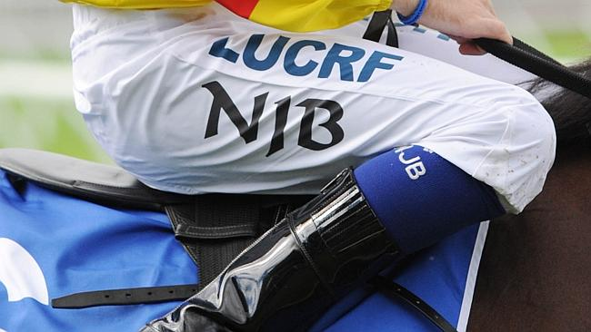 Tommy Berry wears his brother's silks with the initials NJB — Nathan John Berry. Picture: