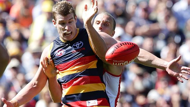 Adelaide forward Josh Jenkins in all sorts trying to escape Ted Richards. Picture: Sarah Reed