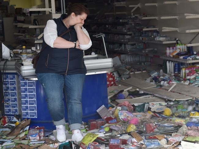 A woman stands in a looted Budnikowsky drugstore after riots in Hamburg's Schanzenviertel district on July 8, 2017 in Hamburg, northern Germany. Picture: AFP/Christof Stache