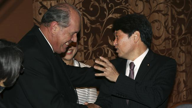 Strong ally ... Australia's Defense Minister David Johnston, left, and his Japanese counterpart Itsunori Onodera, right, shake hands during a meeting in Tokyo. Picture: Eugene Hoshiko