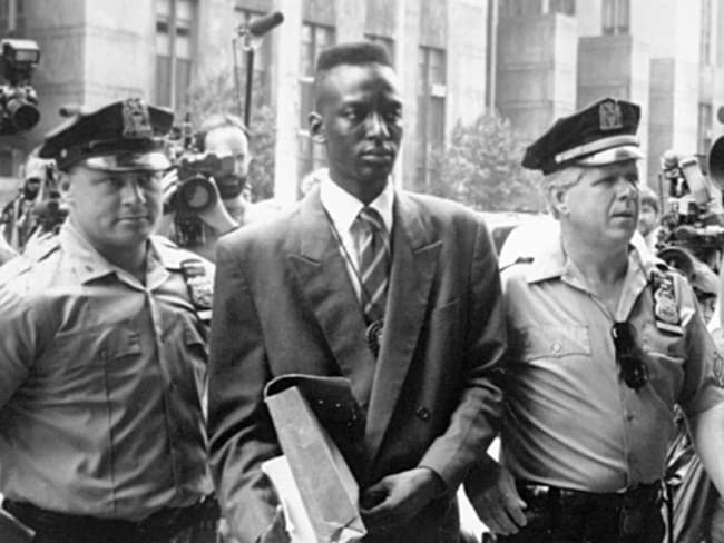 "Payout ... a 1990 file photo shows Yusef Salaam, one of the exonerated ""Central Park Five"", being escorted by police in New York. Picture: AP"