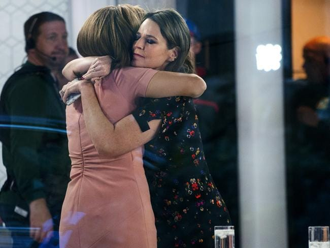 Today host Savannah Guthrie embraces colleague Hoda Kotb after news of Matt Lauer's axing became public. Picture: AP Photo/Craig Ruttle