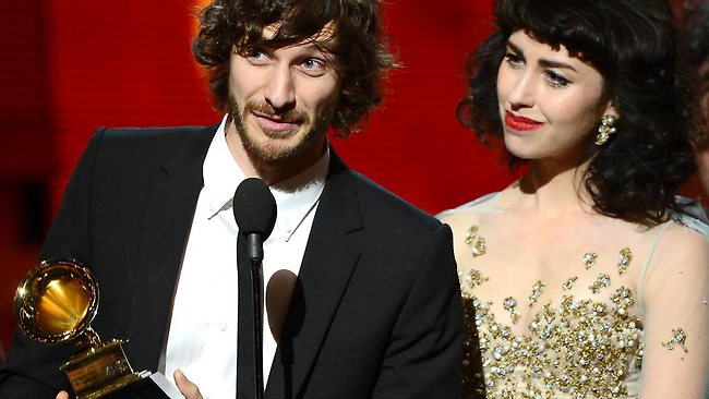 "Gotye (left) and Kimbra accept the Record of the Year award for ""Somebody That I Used to Know''."