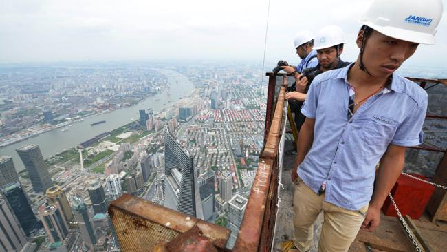 Journalists look at the view from the top of the tower. Picture: AFP