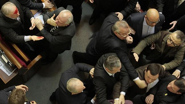 Punches are thrown on the floor of the Ukrainian parliament. Picture: Sergei Chuzavkov