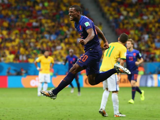 Georginio Wijnaldum of the Netherlands celebrates scoring his team's third goal during the 2014 World Cup third place playoff against Brazil.