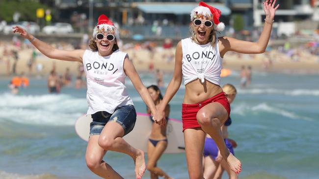 Meanwhile in Sydney: (L-R) Lenka Bohorova, 28 and Jana Trckova, 28 enjoy the hot weather at Bondi Beach yesterday with perfect conditions set to continue today. Picture: Craig Wilson