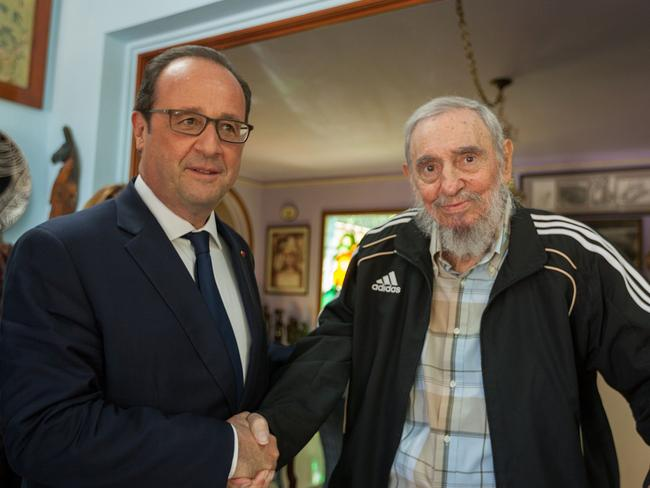 This file handout picture shows French President Francois Hollande (L) posing for a picture with Cuban historical leader Fidel Castro during a meeting in Havana. Picture: AFP.