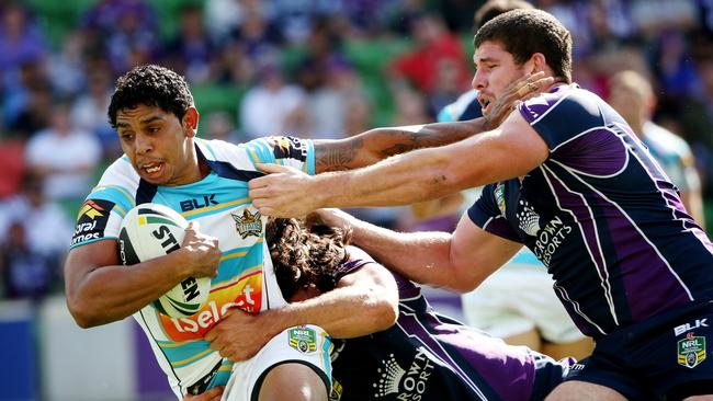 Albert Kelly tackled by Tohu Harris and Mitch Garbutt.