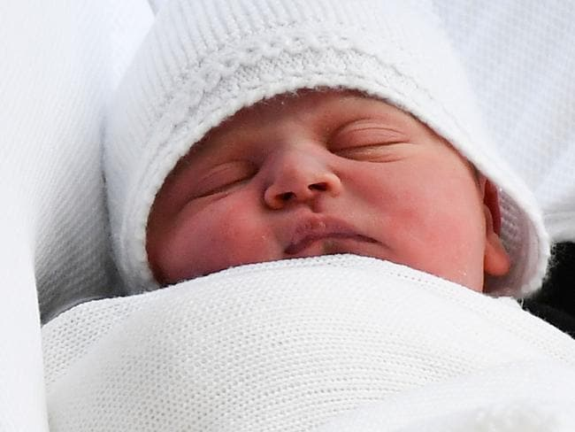 The baby prince snoozed through the drama as he was placed in the royal Range Rover on Monday evening and driven home to Kensington Palace. Picture: AFP Photo / Ben Stansall