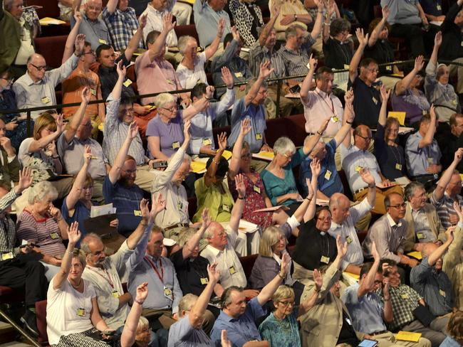 Making history ... members of the Church of England's Synod vote on one of the motions during the session during which approved the consecration of women bishops. Picture: Nigel Roddis