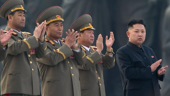 North Korean leader Kim Jong-Un claps during the unveiling ceremony of two statues of former leaders Kim Il-Sung and Kim Jong-Il in Pyongyang.