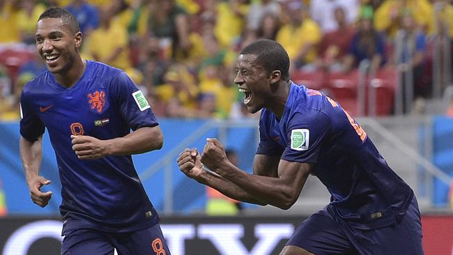 Netherlands' Georginio Wijnaldum, right, celebrates with Jonathan de Guzman.
