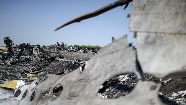 Painstaking work ... most of the victims' remains have been recovered from the MH17 crash site.