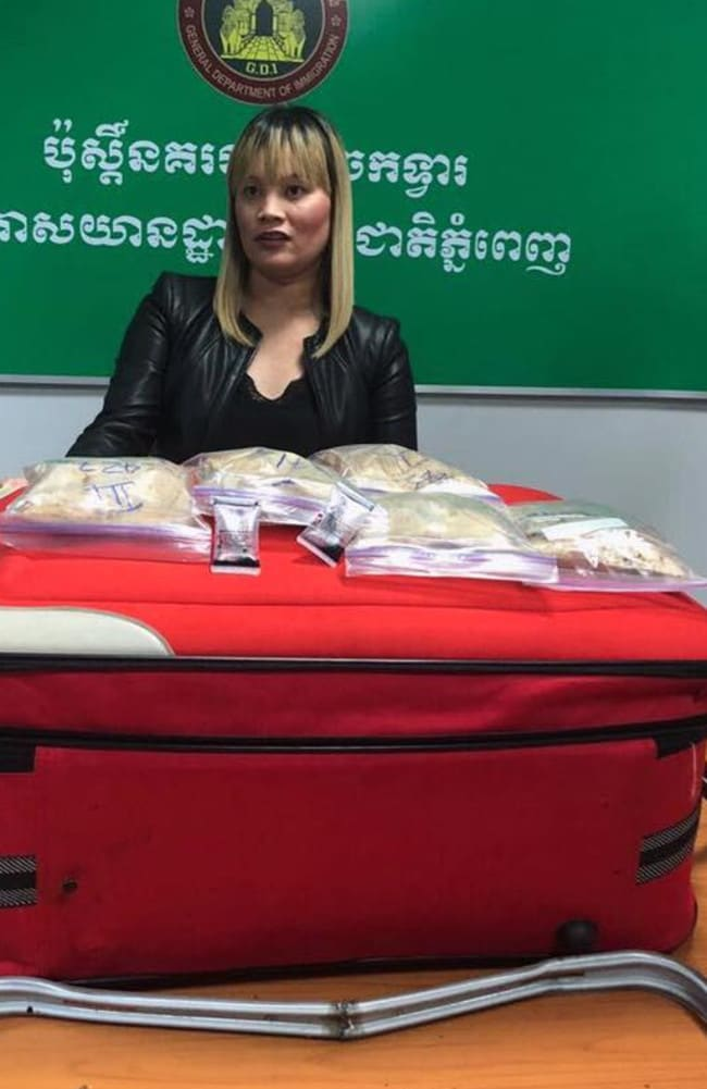 Ms Tran posed with the seven bags of powder atop her red suitcase after her arrest. Picture: Khmer Immigration Department