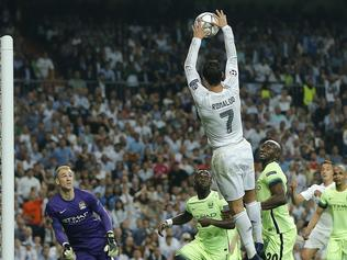 Real Madrid's Cristiano Ronaldo handles the ball during the Champions League semifinal second leg soccer match between Real Madrid and Manchester City at the Santiago Bernabeu stadium in Madrid, Wednesday May 4, 2016. (AP Photo/Paul White)