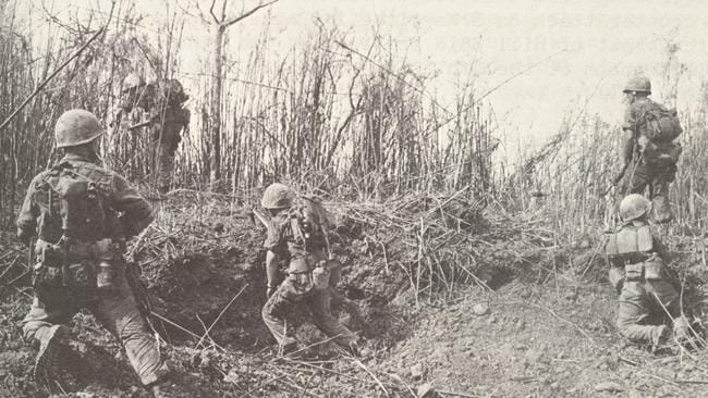 Marines inch their way toward the summit of Hill 881N during the Hill fights of The Battle for Khe Sanh. Official USMC Photograph A189161 public domain