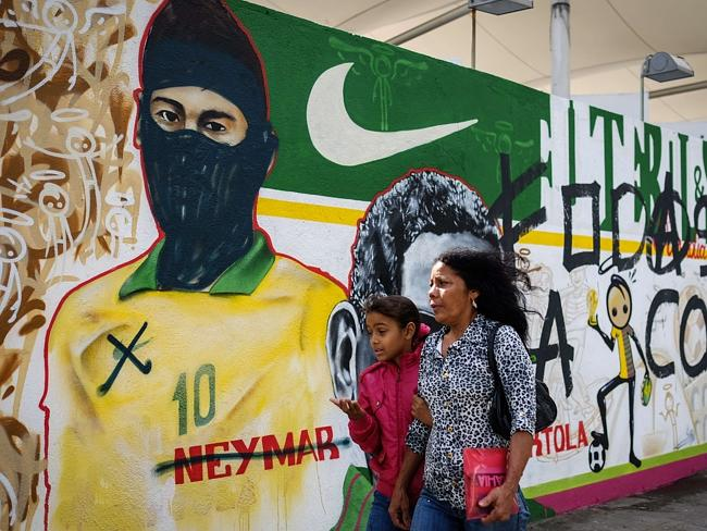 Villain ... Graffiti depicts Brazilian national footballer Neymar with a hood used by mem