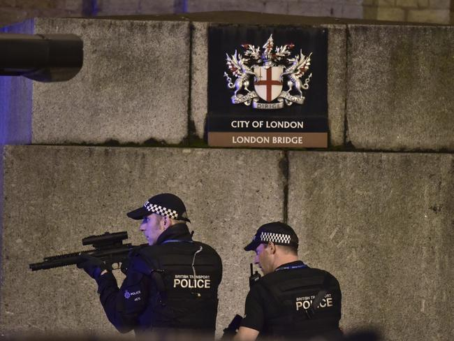 An armed Police officer looks through his weapon on London Bridge. Picture: PA