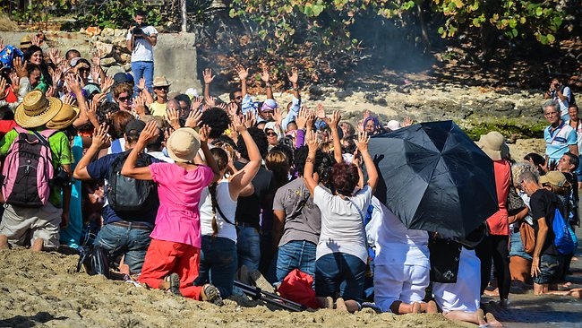 Cubans participate in a Mayan ritual at Bacuranao beach in eastern Havana, on December 6 to celebrate the beginning of a new era. Picture: AFP